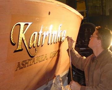 drew applying gold leaf to a mahogany boat transom columbus ohio
